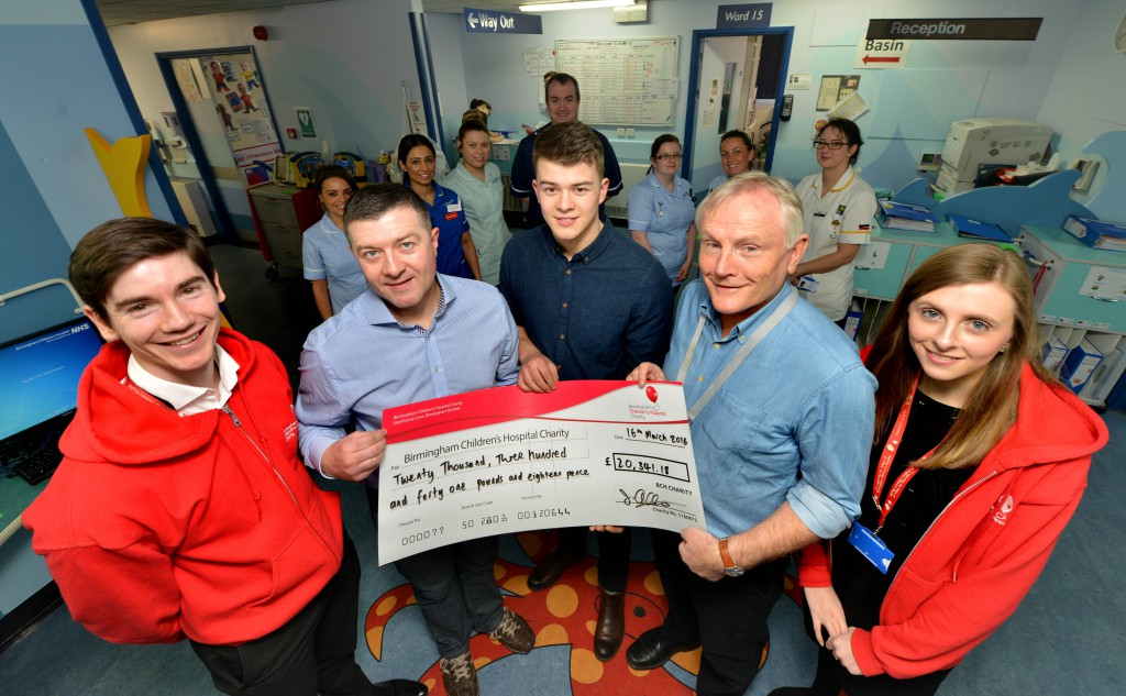 cheque presentation £20,000 to BCH Json and Scott Addison, centre along with Doctor Mike Williams hand over a cheque for over £20.000 to James Lunney and Lilly Pye from The Fundraising team at Birmingham Children's Hospital in Birmingham. The money was raised with a trek along the Great Wall of China. ( No wedding day pic available ) . .